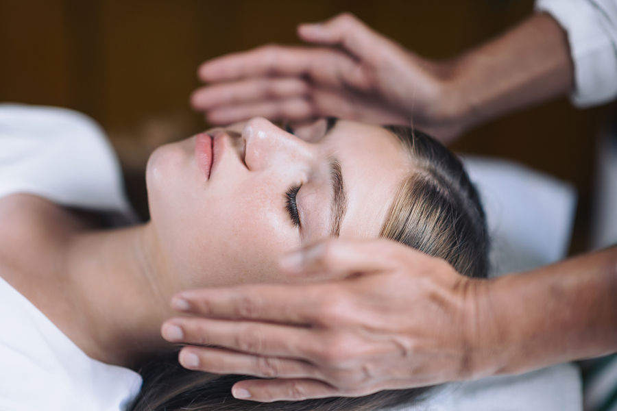 Reiki Healing Treatment With Teenage Girl